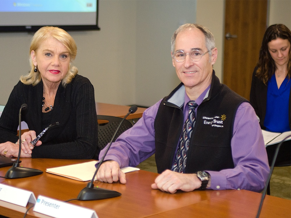 Energy Trust employees at conference table at a board meeting