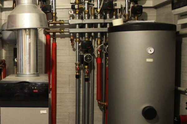 House boiler, water heater, expansion tank and other pipes. newmodern independent heating system in boiler room, gas