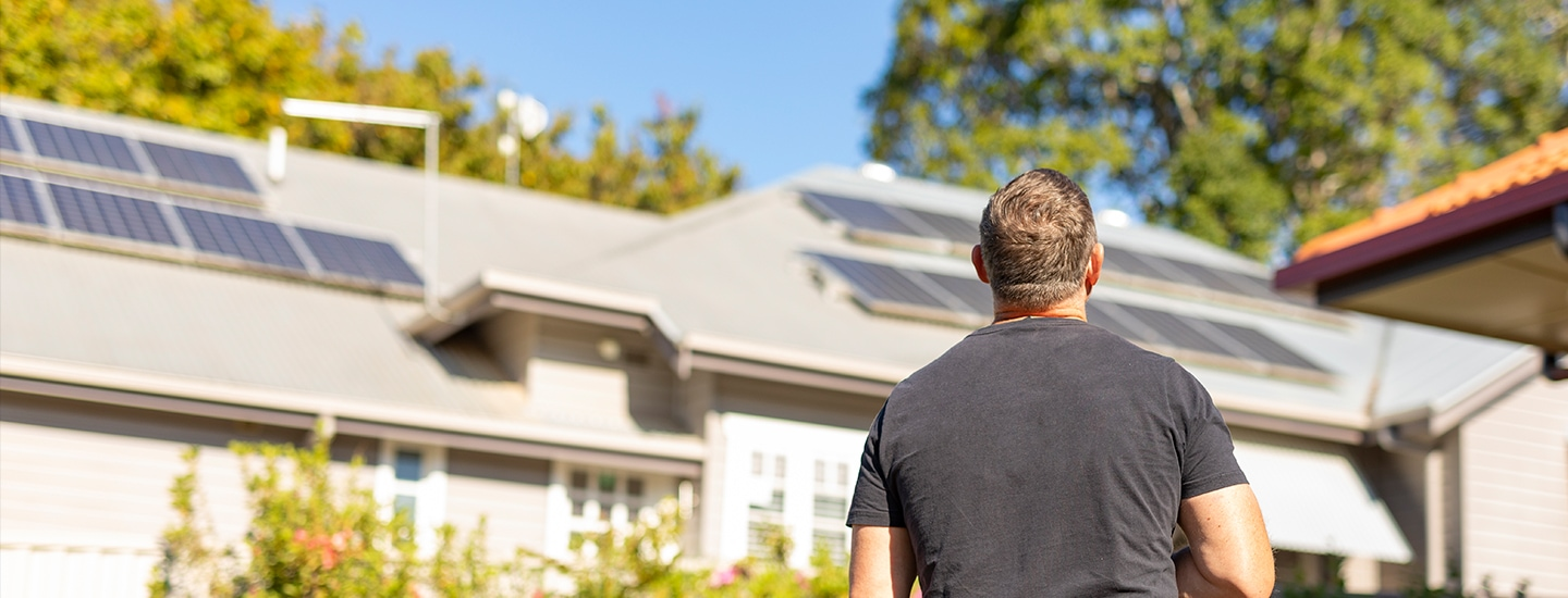 man in front of house with solar